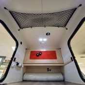 Full interior view of an Adventure camping trailer at Earthship Overland at their showroom in Englewood, CO