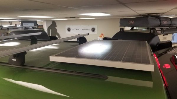 Solar panel on top exterior of a green Adventure camping trailer at Earthship Overland at their showroom in Englewood, CO
