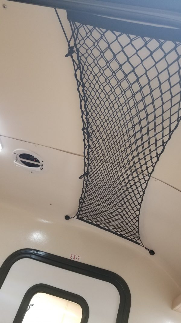 Storage net on ceiling inside of an Adventure camping trailer at Earthship Overland at their showroom in Englewood, CO