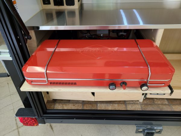 Closed Red camping grill at Earthship Overland's showroom in Englewood, CO