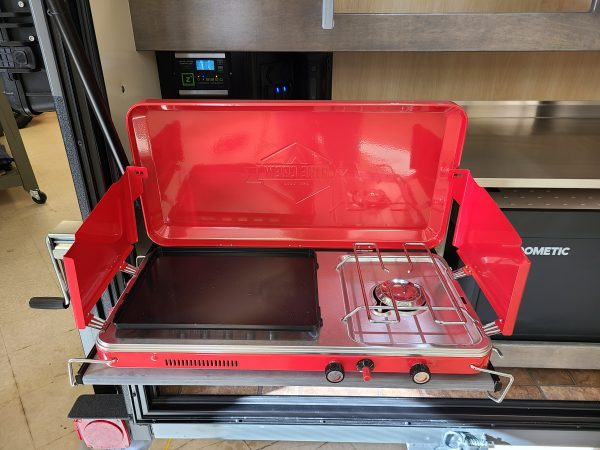 Red camping grill at Earthship Overland's showroom in Englewood, CO
