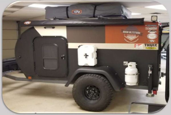 exterior of a High Altitude adventure camping trailer at Earthship Overland at their showroom in Englewood, CO